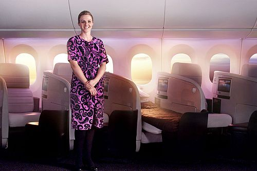 Air New Zealand Flight Attendant Welcoming Guests to the Business Premier Cabin