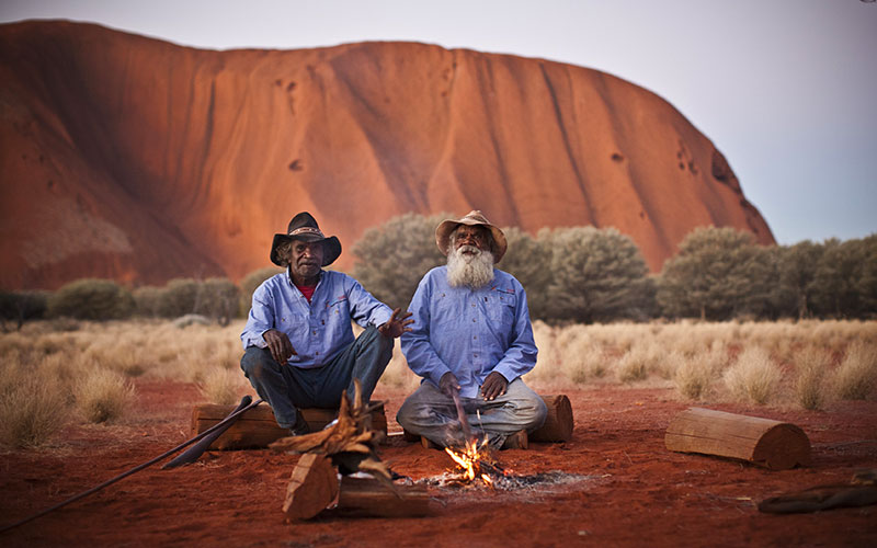 Aboriginal guides having a campfire at Uluru