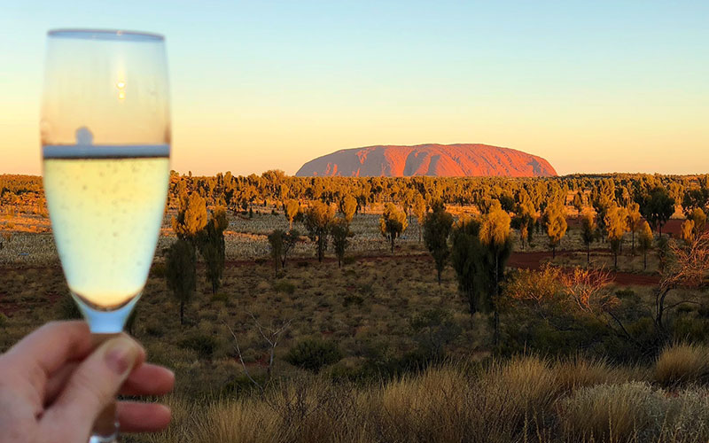 Raising a glass to Ayers Rock at sunset