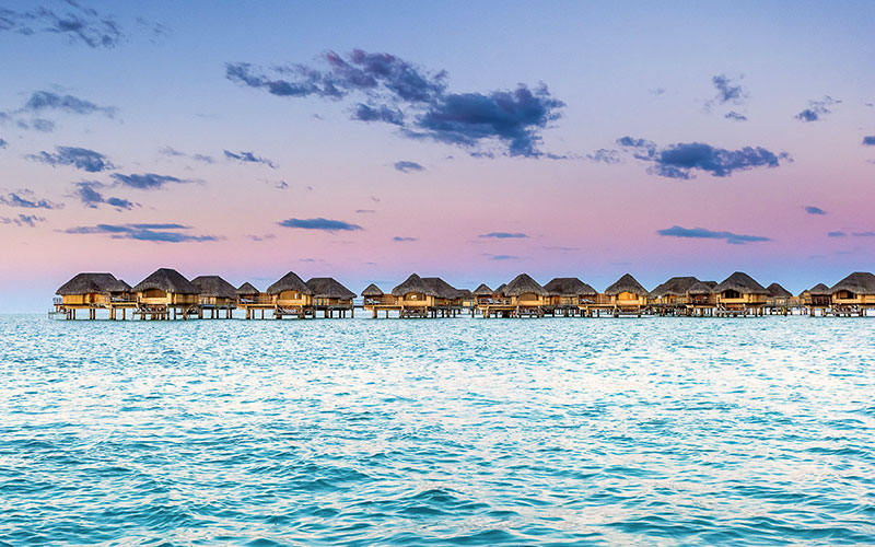 Overwater Bungalows at Sunset - Le Taha'a Resort