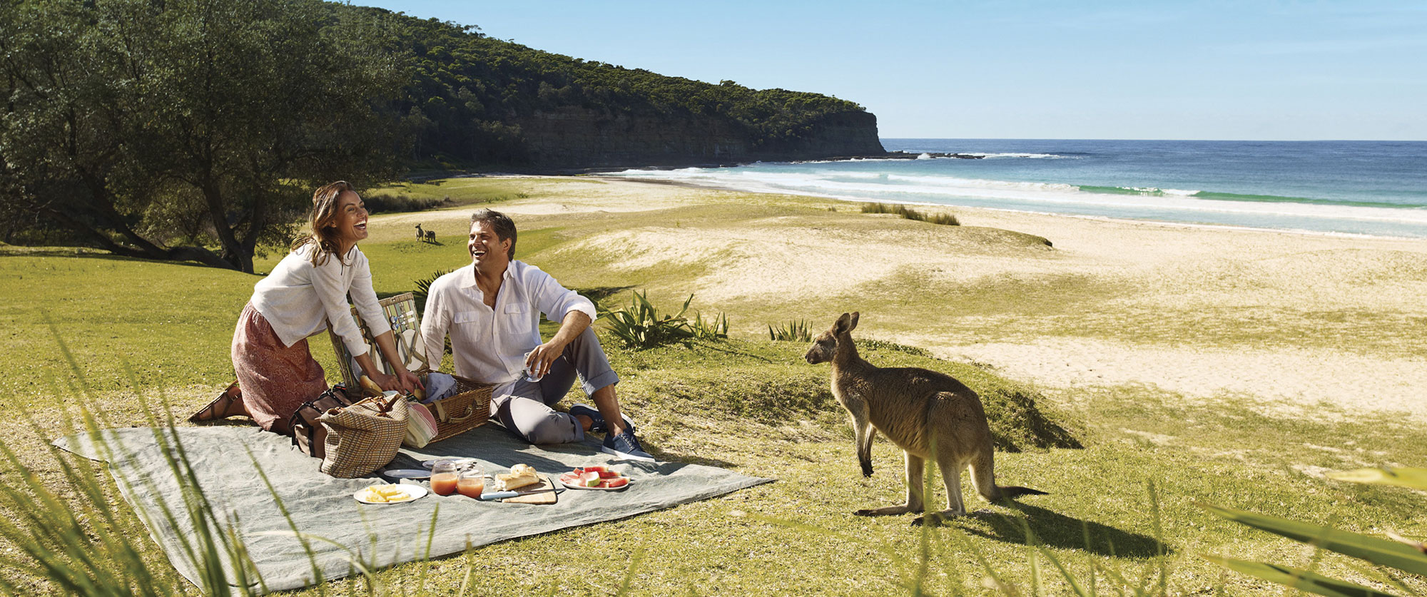 best multi destination travel packages - Pebbly beach couple - Kangaroo beach
