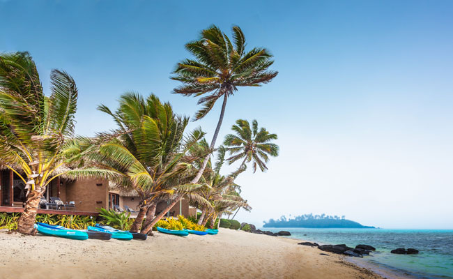 View of the sandy Rumours Beach and lodge- Rumours Luxury Villas & Spa - Travel South Pacific Beaches