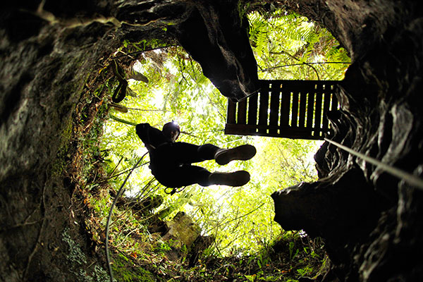 Rappelling in Waitomo Caves, New Zealand