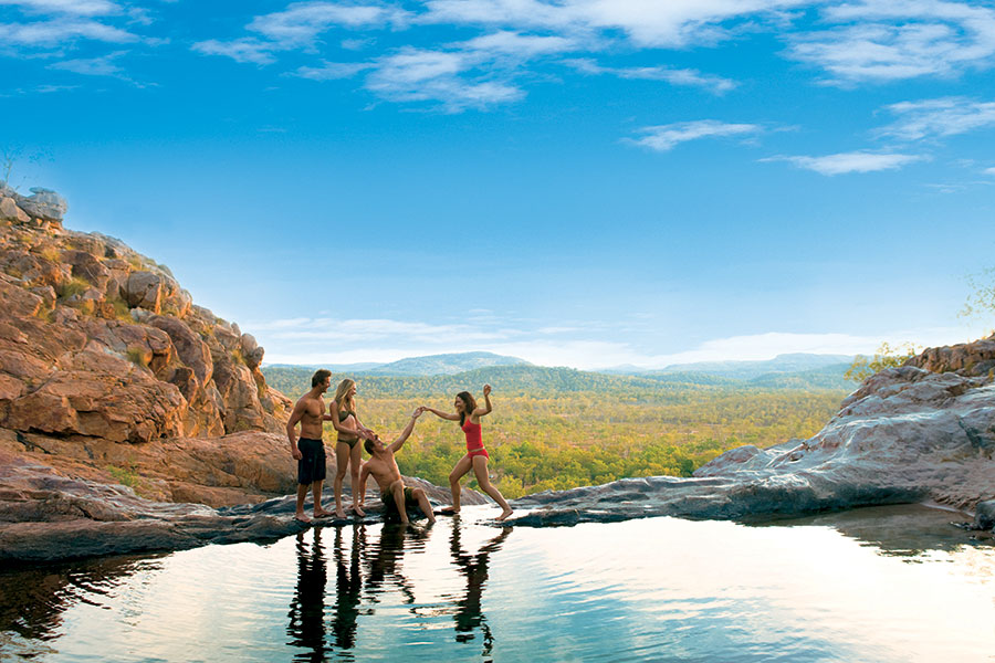Take a dip in Gunlom Falls in Kakadu National Park.